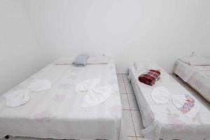 Cama ou camas em um quarto em Pousada LN