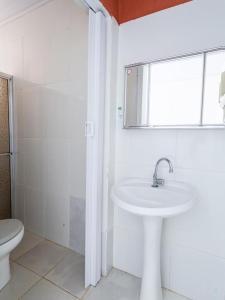 Um banheiro em Pousada LN