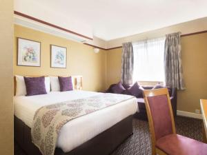 A bed or beds in a room at Derby Station Hotel, Sure Hotel Collection by Best Western