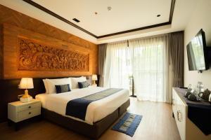 Ein Bett oder Betten in einem Zimmer der Unterkunft Phor Liang Meun Terracotta Arts Hotel