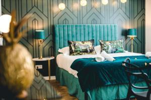 Un ou plusieurs lits dans un hébergement de l'établissement Les Précieuses Suites & SPA