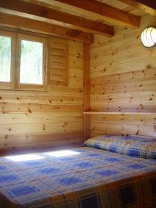 Cama o camas de una habitación en Camping Vall de Ribes