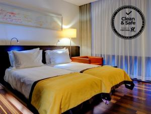 A bed or beds in a room at VIP Grand Lisboa Hotel & Spa