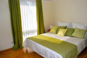 A bed or beds in a room at Boardinghouse Nordpark