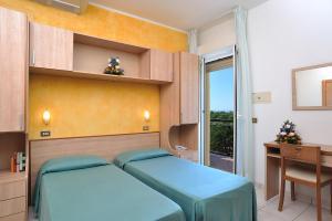 Letto o letti in una camera di Hotel Ausonia