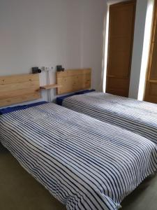 Ein Bett oder Betten in einem Zimmer der Unterkunft Albergue Seminario Menor