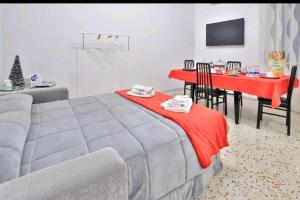 A bed or beds in a room at Casa vacanza Arcangeli