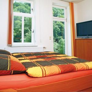 Ein Bett oder Betten in einem Zimmer der Unterkunft Numero1-Pension und Cafe