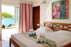 Cama ou camas em um quarto em Villa Vaihau
