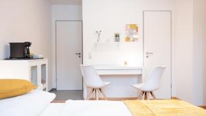 A seating area at Relax Aachener Boardinghouse Phase 3