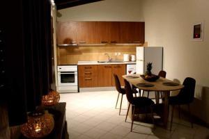 A kitchen or kitchenette at agis apartment corfu