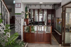 The lobby or reception area at Hotel Oasis