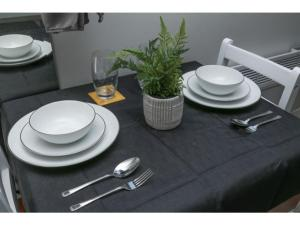 A restaurant or other place to eat at StayZo - Crofton Park - Central London refurbished Studio
