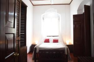 A bed or beds in a room at Kithulvilla Holiday Bungalow