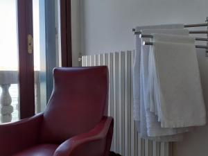 A seating area at Apartment Il Giardino dell'Eden