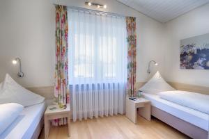 Ein Bett oder Betten in einem Zimmer der Unterkunft Appartementhaus Regina