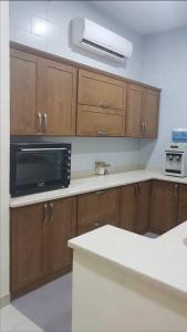 A cozinha ou cozinha compacta de استراحة أصداف