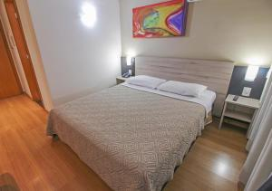 A bed or beds in a room at Stop Inn Plus Pampulha
