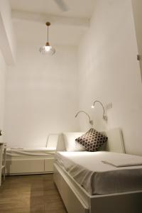 Cama o camas de una habitación en Inhawi Boutique Hostel