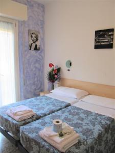 Кровать или кровати в номере Hotel Villa Elia