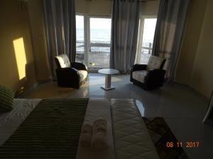 A seating area at Fini Hotel Bobende