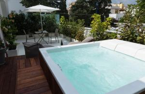 The swimming pool at or near Unìco Boutique Hotel d'Arte