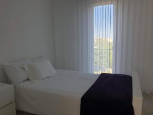 A bed or beds in a room at Charming House - Lisbon