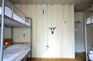 A bunk bed or bunk beds in a room at Five Elements Hostel Frankfurt