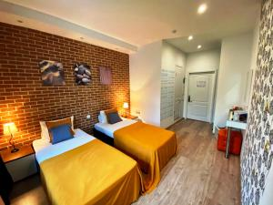 A bed or beds in a room at CityComfort Hotel Kitay- Gorod