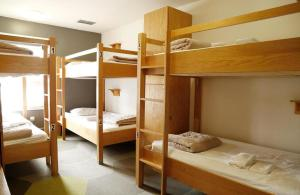 A bunk bed or bunk beds in a room at HI Calgary City Centre Hostels