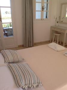 Ένα ή περισσότερα κρεβάτια σε δωμάτιο στο Elizabeth