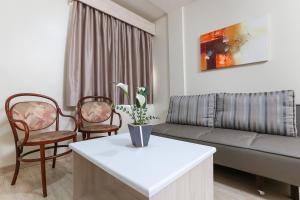 Uma área de estar em Hotel Express Aeroporto
