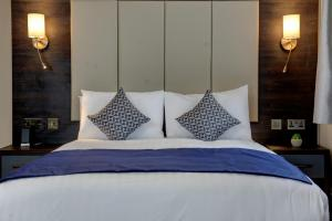 A bed or beds in a room at Trafford Hall Hotel, BW Signature Collection by Best Western