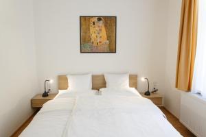 Postel nebo postele na pokoji v ubytování Apartments Villa Whitehouse