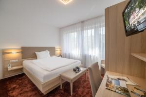 Ein Bett oder Betten in einem Zimmer der Unterkunft Hotel Brenner