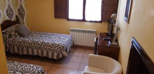A bed or beds in a room at Pozolico Hotel Rural