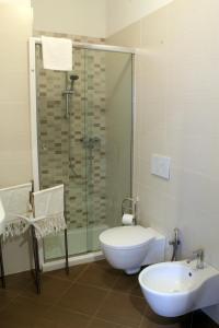 A bathroom at MARIMAR - Apartments OTRANTO