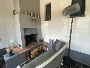 Een TV en/of entertainmentcenter bij Studio & Appartement au Lac