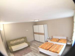 Łóżko lub łóżka w pokoju w obiekcie U Andrzeja