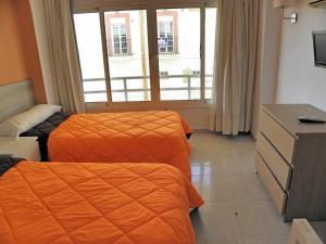 Cama o camas de una habitación en JSM Apartamentos