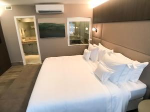 Cama ou camas em um quarto em Radisson Blu Belo Horizonte Savassi