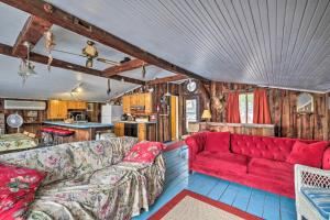 A seating area at Quiet Cabin on Glen Lake with Boat Dock and Deck!