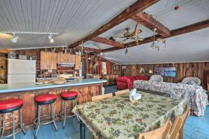 A restaurant or other place to eat at Quiet Cabin on Glen Lake with Boat Dock and Deck!