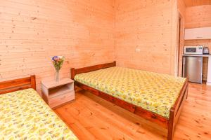 A bed or beds in a room at Zydroji Liepsna