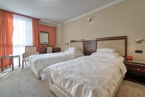 Кровать или кровати в номере Hotel Bosna AD