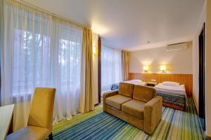 Кровать или кровати в номере Яхонты Истра