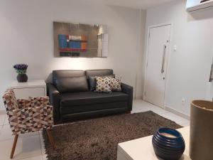 Uma área de estar em Apartment Copacabana III