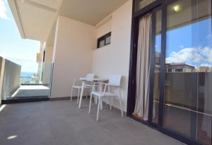 A balcony or terrace at Hotel Adonis Capital