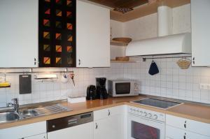 Küche/Küchenzeile in der Unterkunft Ferienwohnung Am Sundern