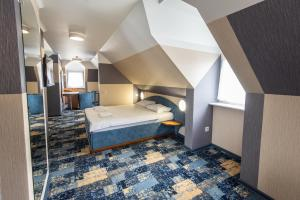 A bed or beds in a room at Oberteich